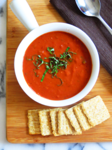 tomato soup and crackers in table