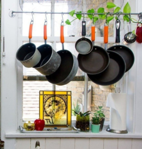 pots hanging in the kitchen above the sink
