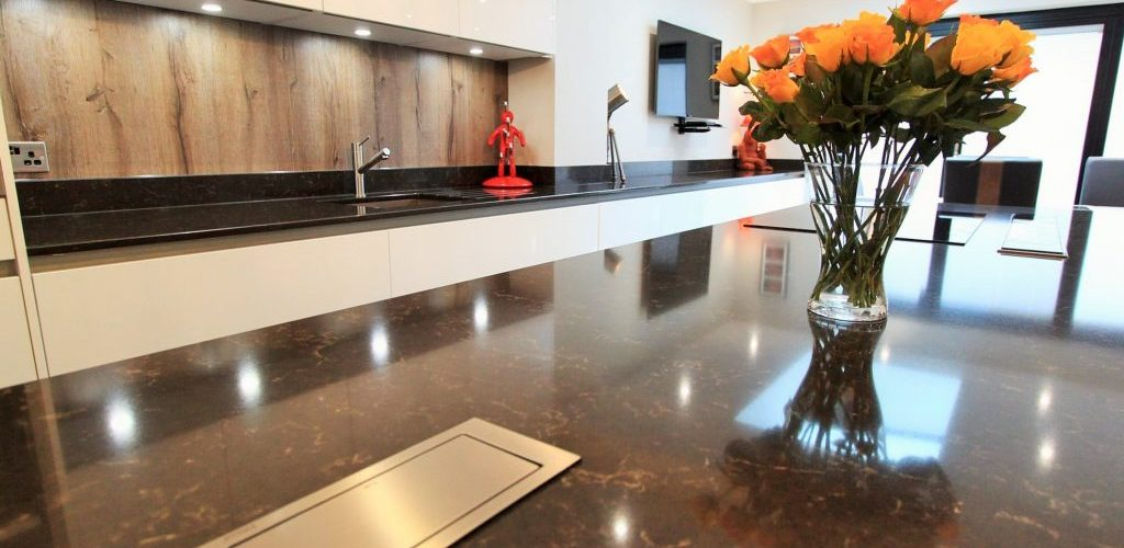Trinity Close black granite kitchen island with flowers in a vase