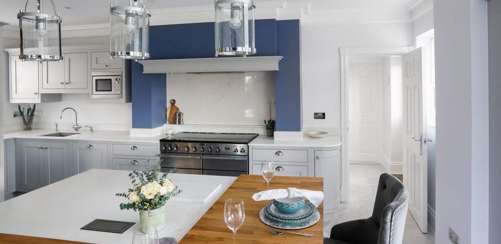 Hamilton House blue and white kitchen design with wood table