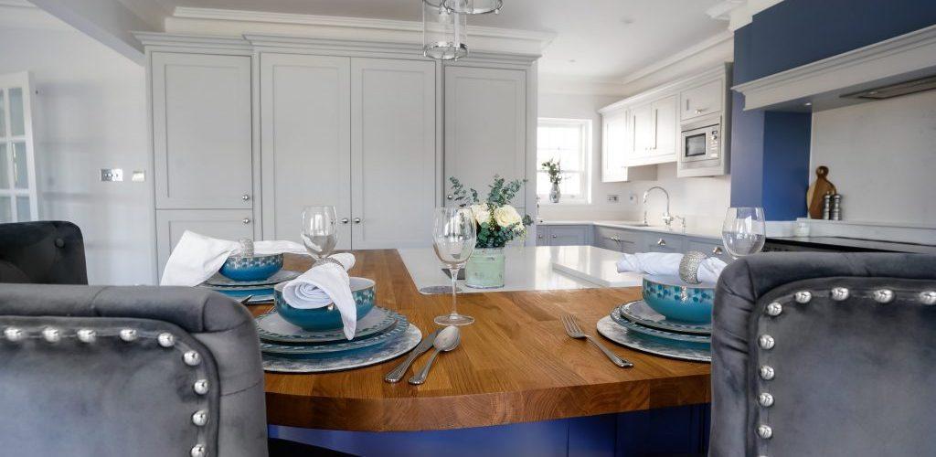Hamilton House kitchen island view with table setup