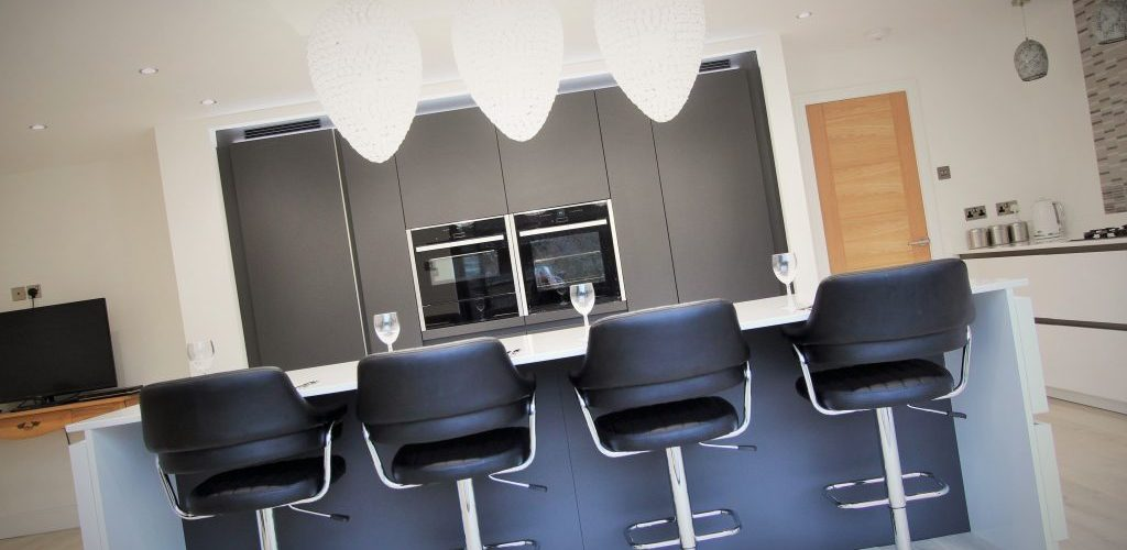 Uplands Road kitchen viewwith black high chairs