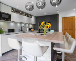 Whitehouse Chase kitchen design with chairs