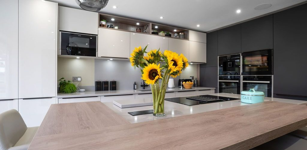 whitehouse chase with a sunflower in a vase on top of the counter top