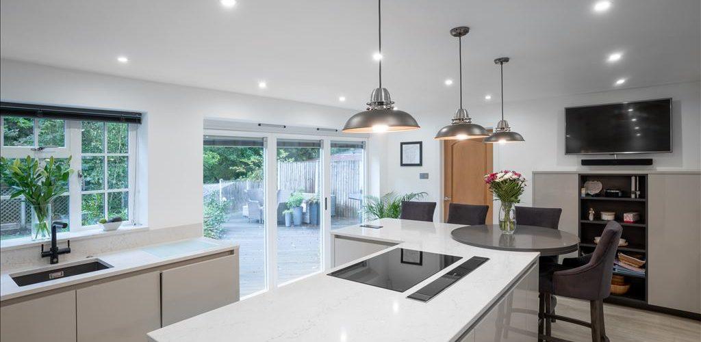 Warren Road stylist white kitchen design with outdoor view