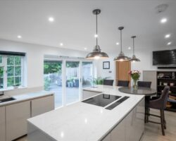 Warren Road stylist white kitchen design with outdoor view