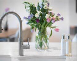 Weare Giffard kitchen faucet with flower vase